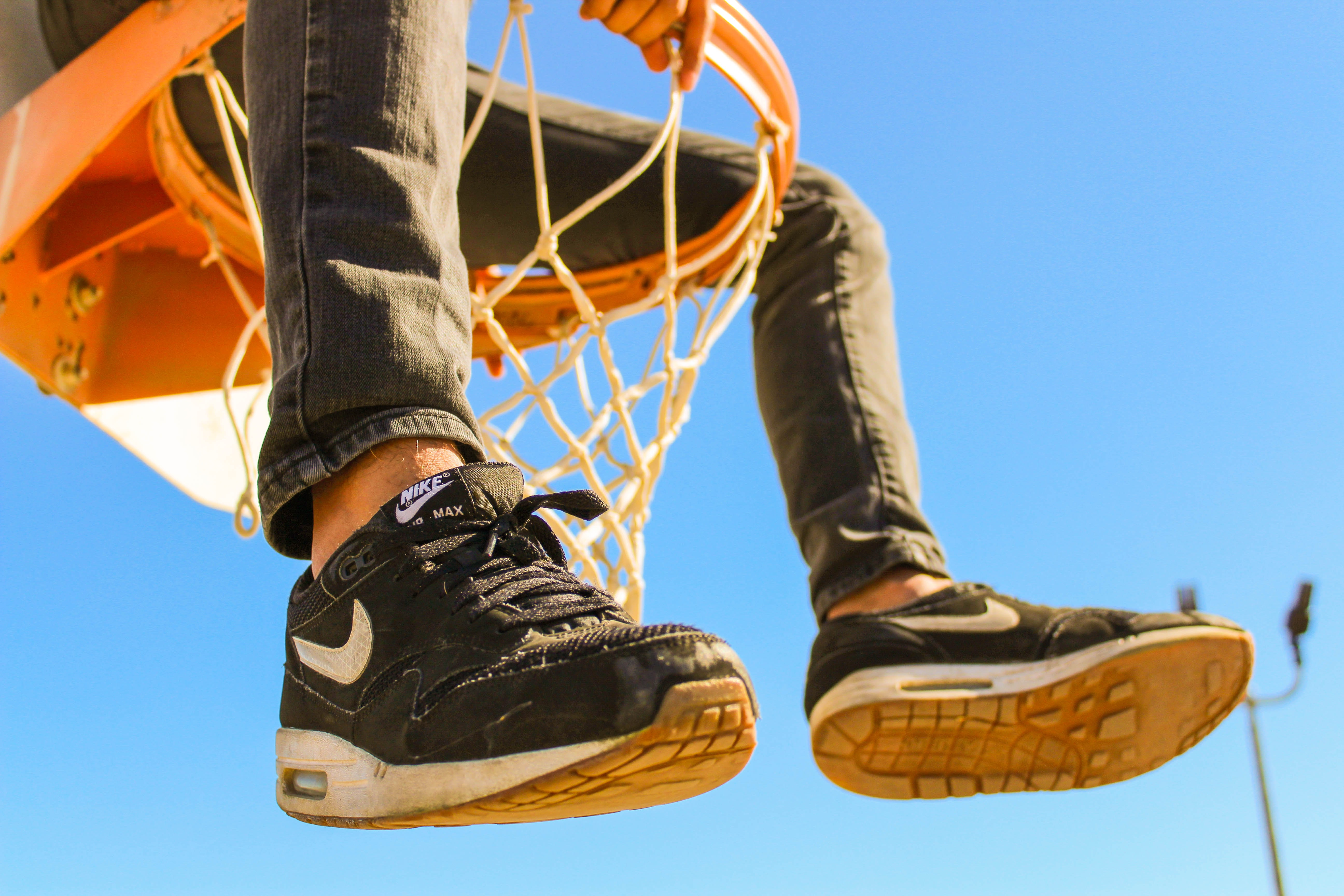 person sitting on basketball ringboard