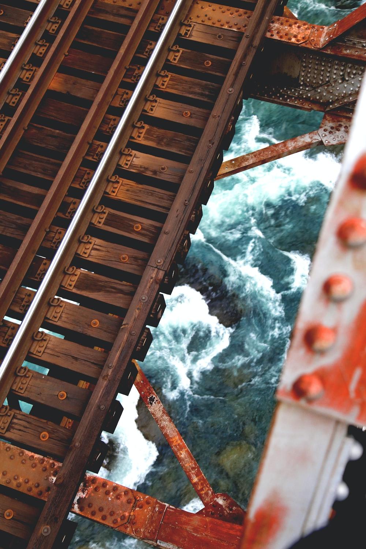 river under wooden frame during daytime