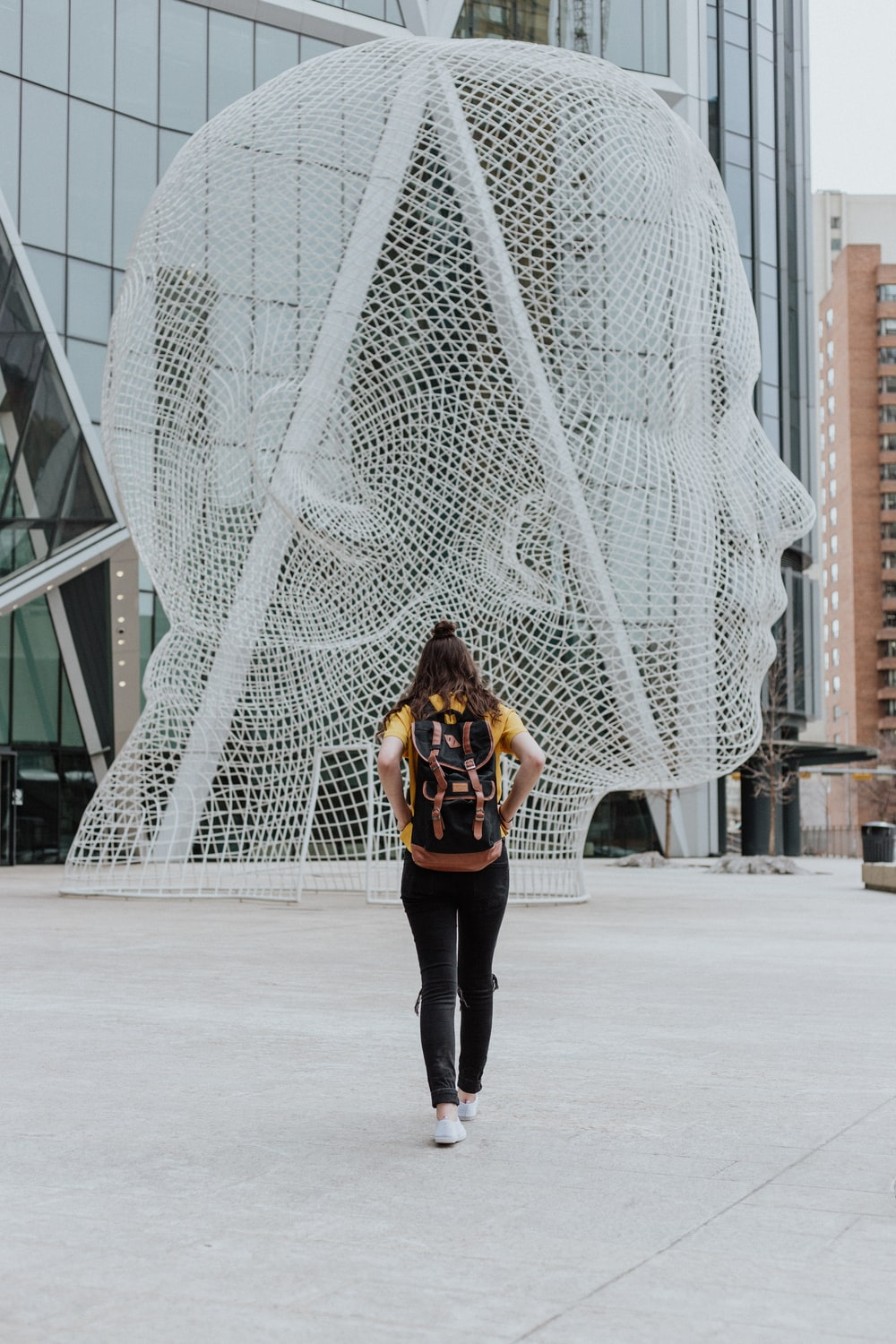 Canadian universities without application fees: face statue in Calgary