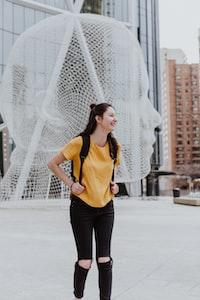 woman wearing yellow t-shirt laughing