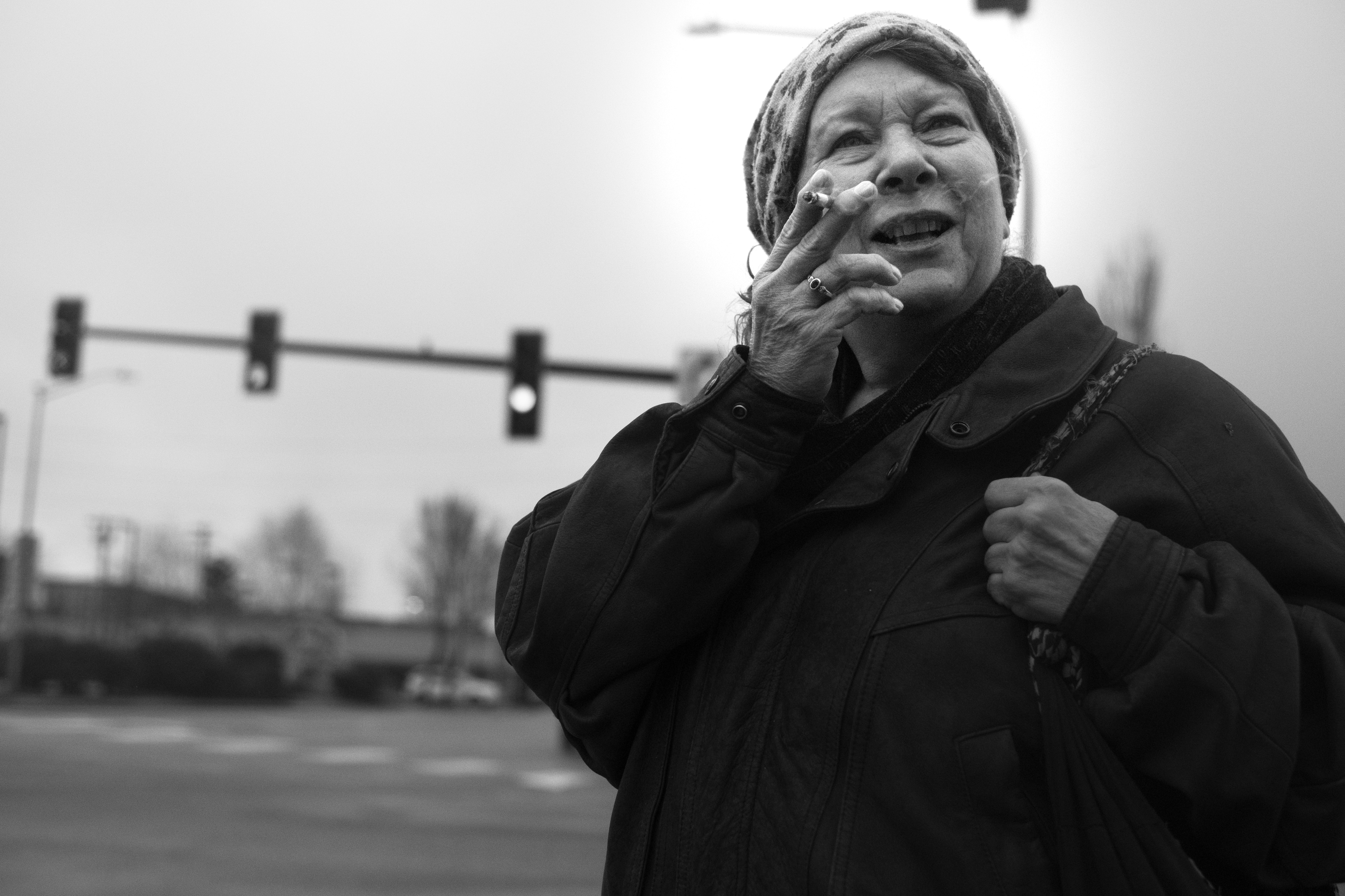 grayscale photo of woman holding cigarette stick