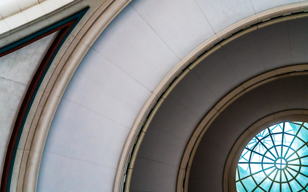 low angle photo of dome glass ceiling