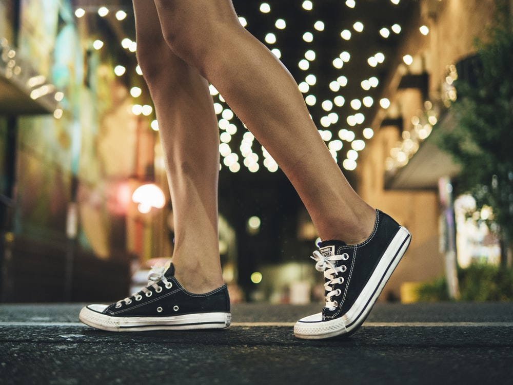 person wearing black-and-white low-top sneakers