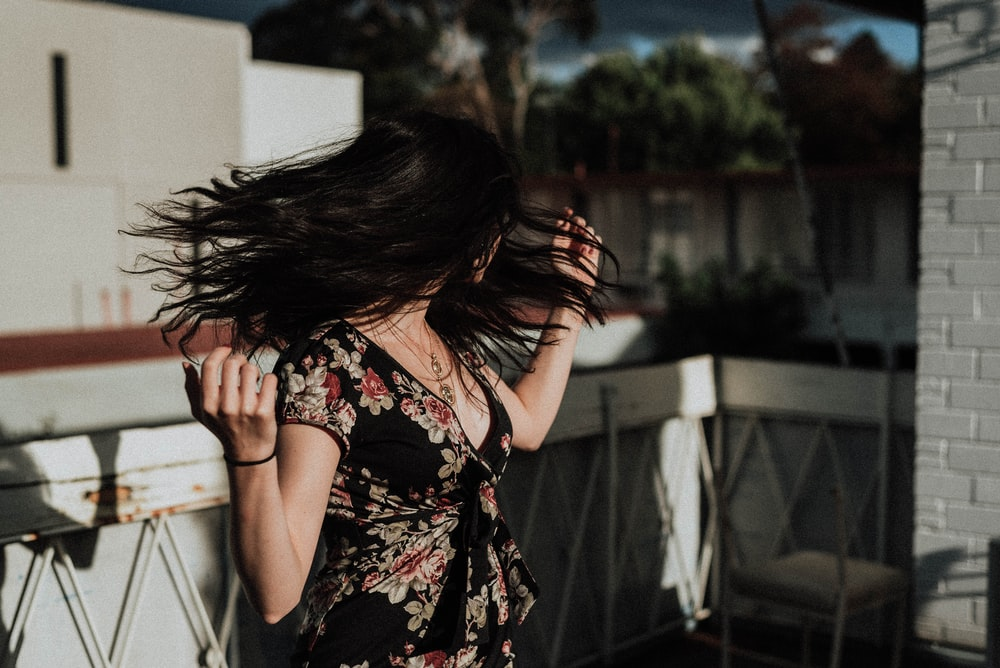 woman shaking her hair on terrace