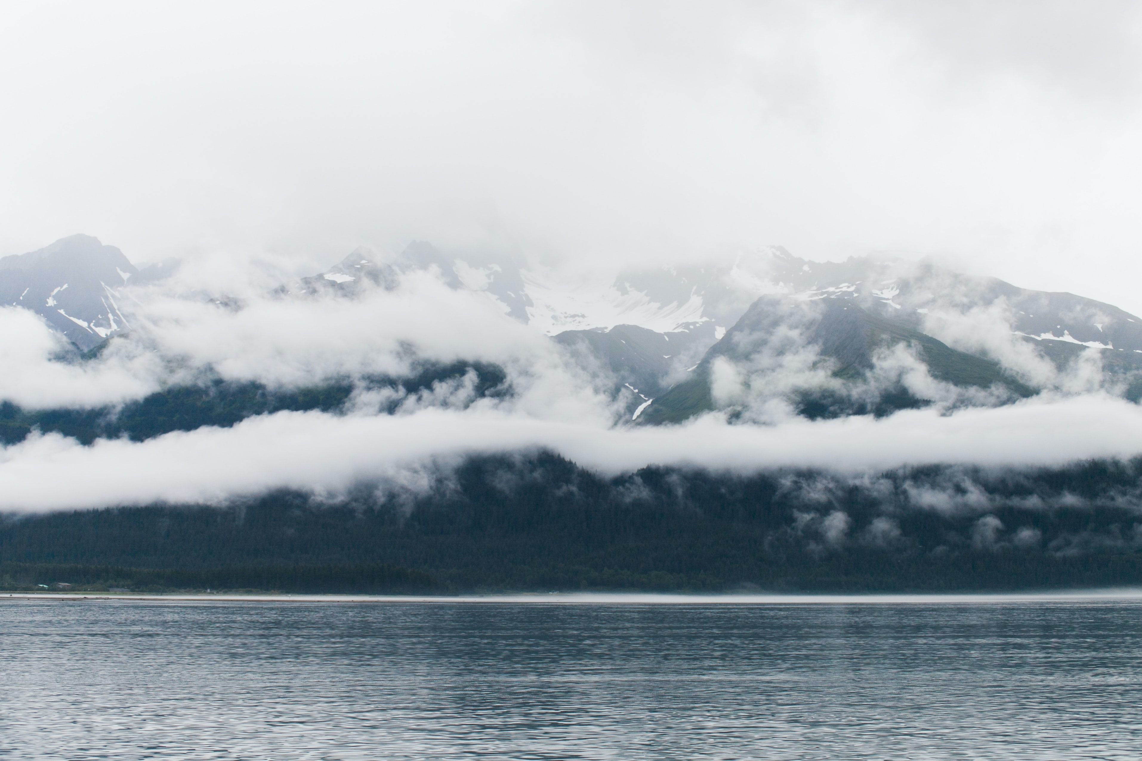 cloudy sky covered mountain taken at daytime