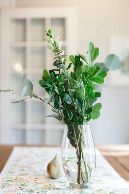 leaves arrangement in vase on table