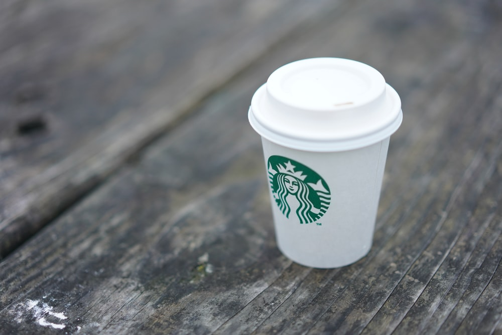 white Starbucks disposable cup