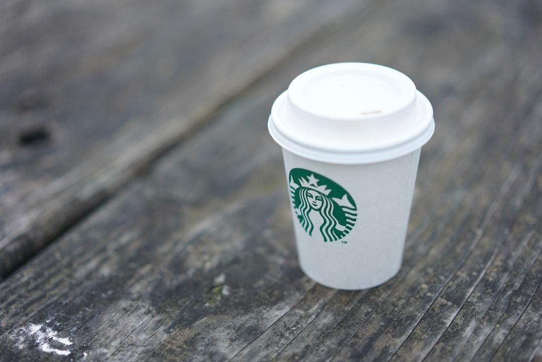 Starbucks Coffee Cup on Vintage Table