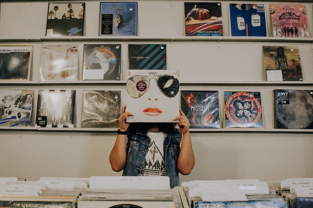 person covering face with vinyl sleeve