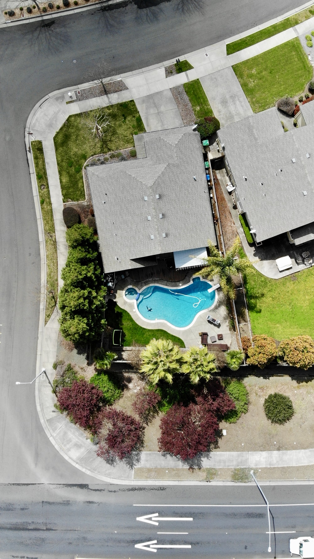 aerial photography of house with swimming pool near road