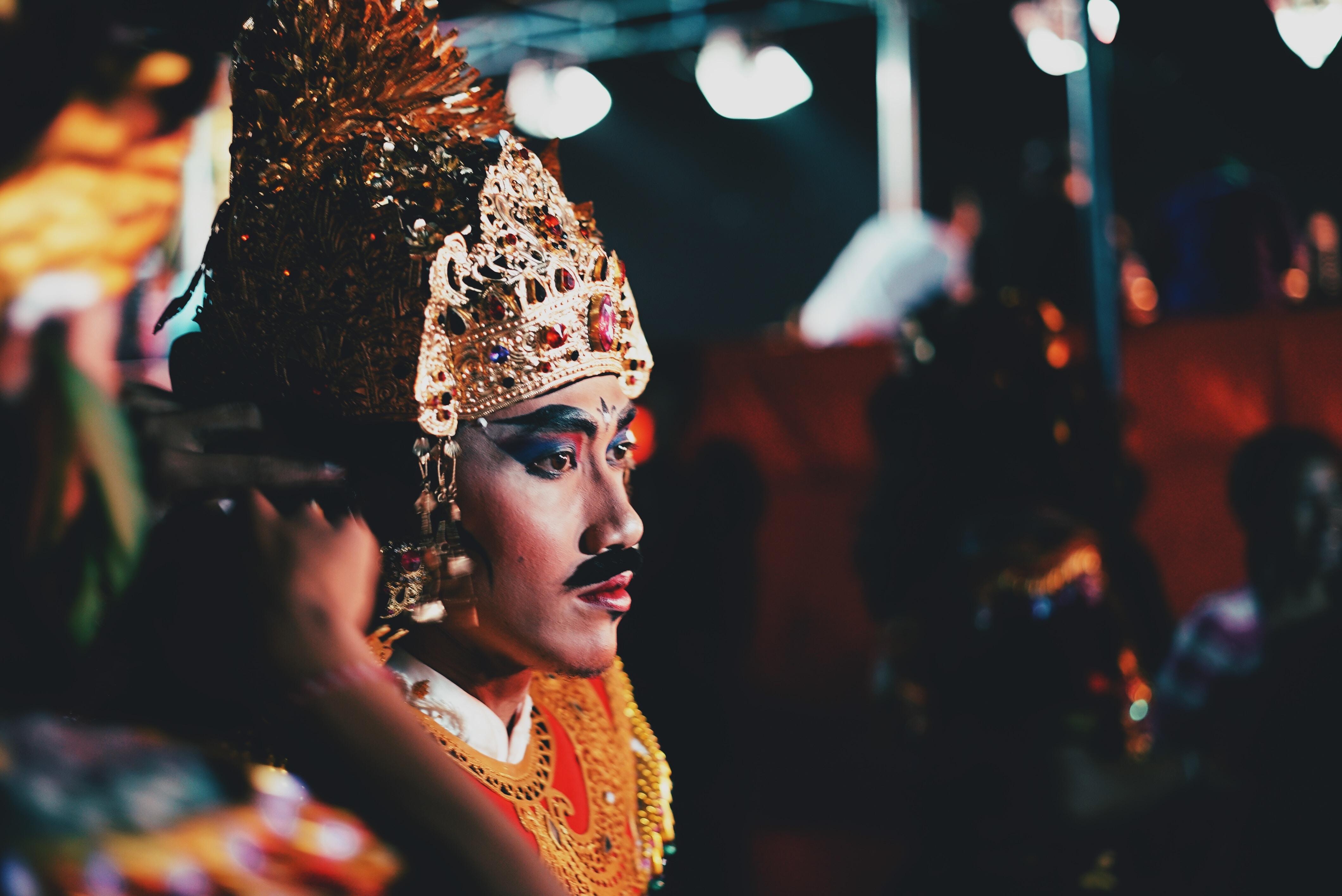 selective photograph of man wearing gold headress