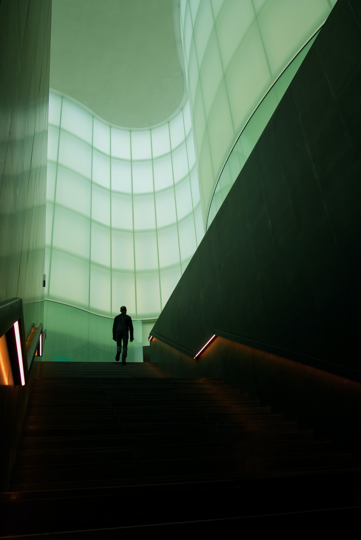 man walking on stair inside building