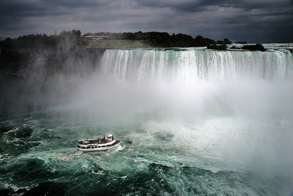 aerial photography of white and brown ship on Niagara, Canada falls during daytime