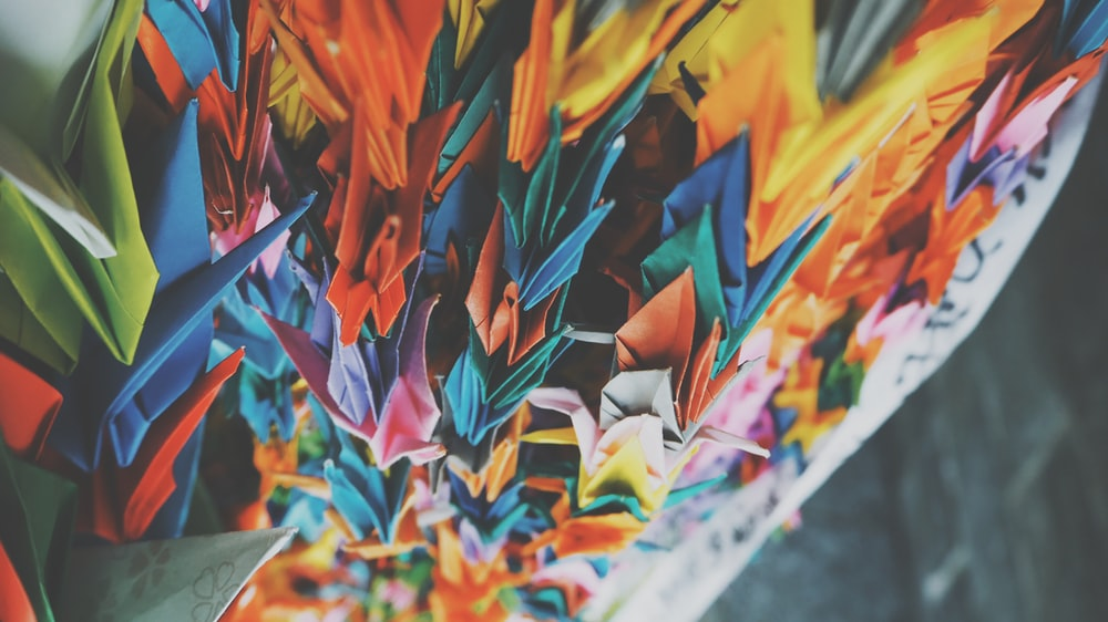 shallow focus lens photo paper origami
