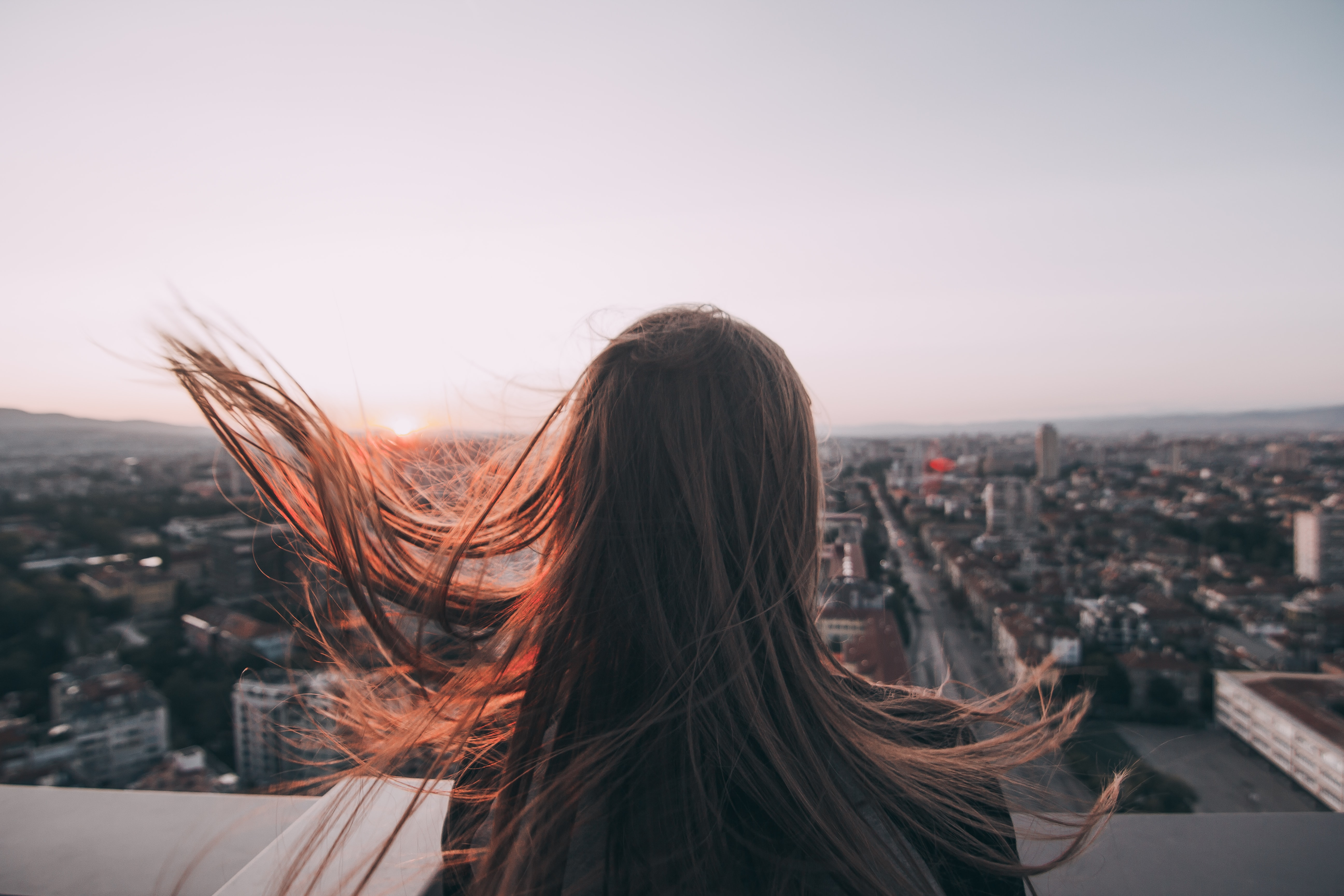 woman standing on rooftop