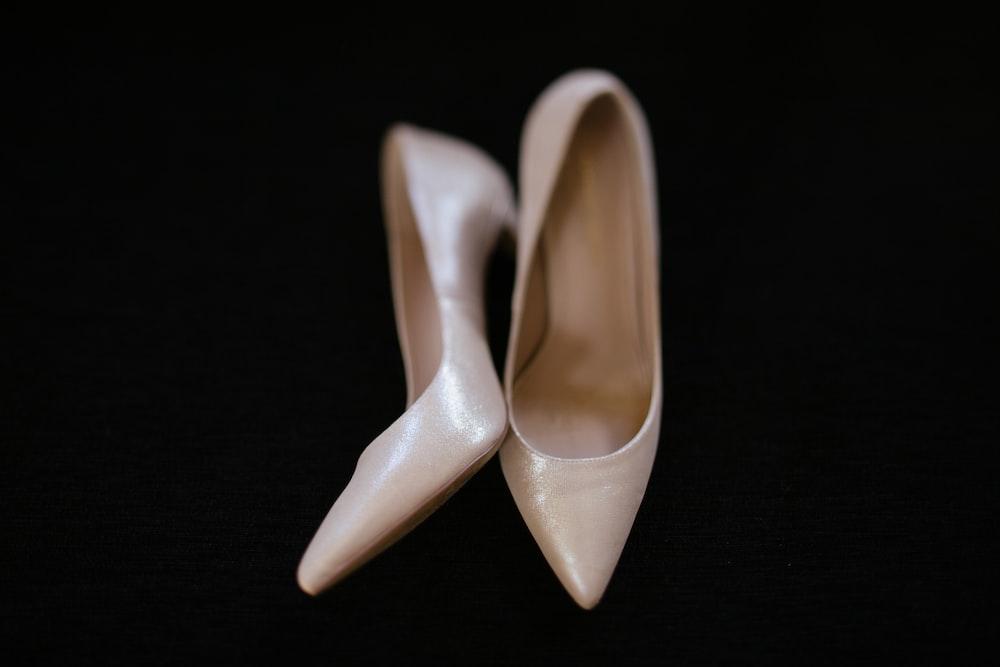 pair of women's white stilettos