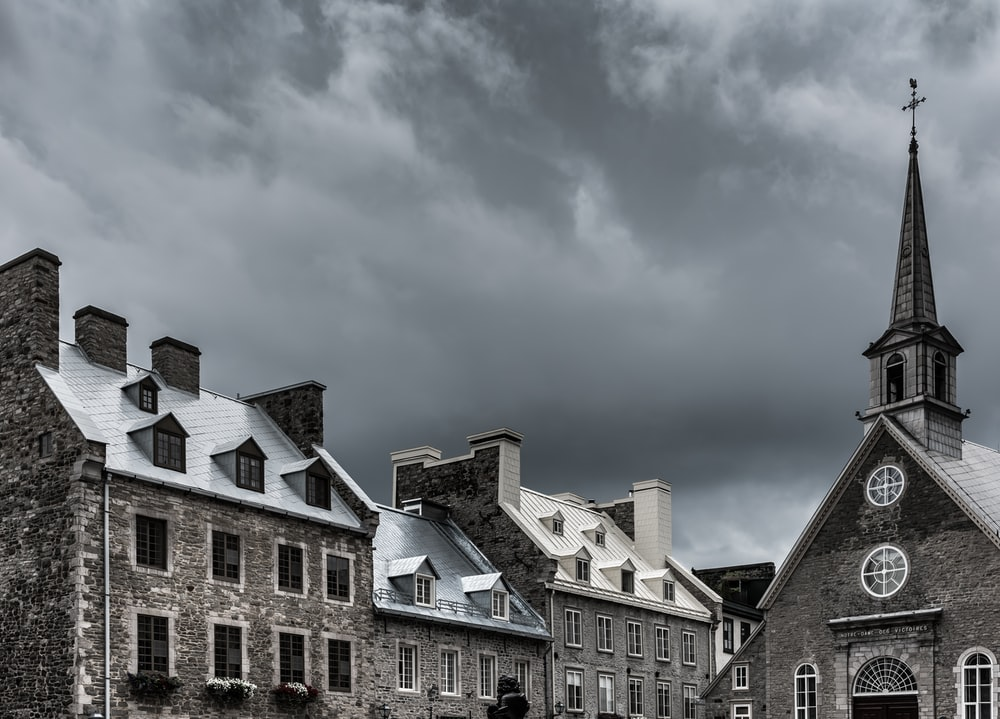 brown church in cloudy skies