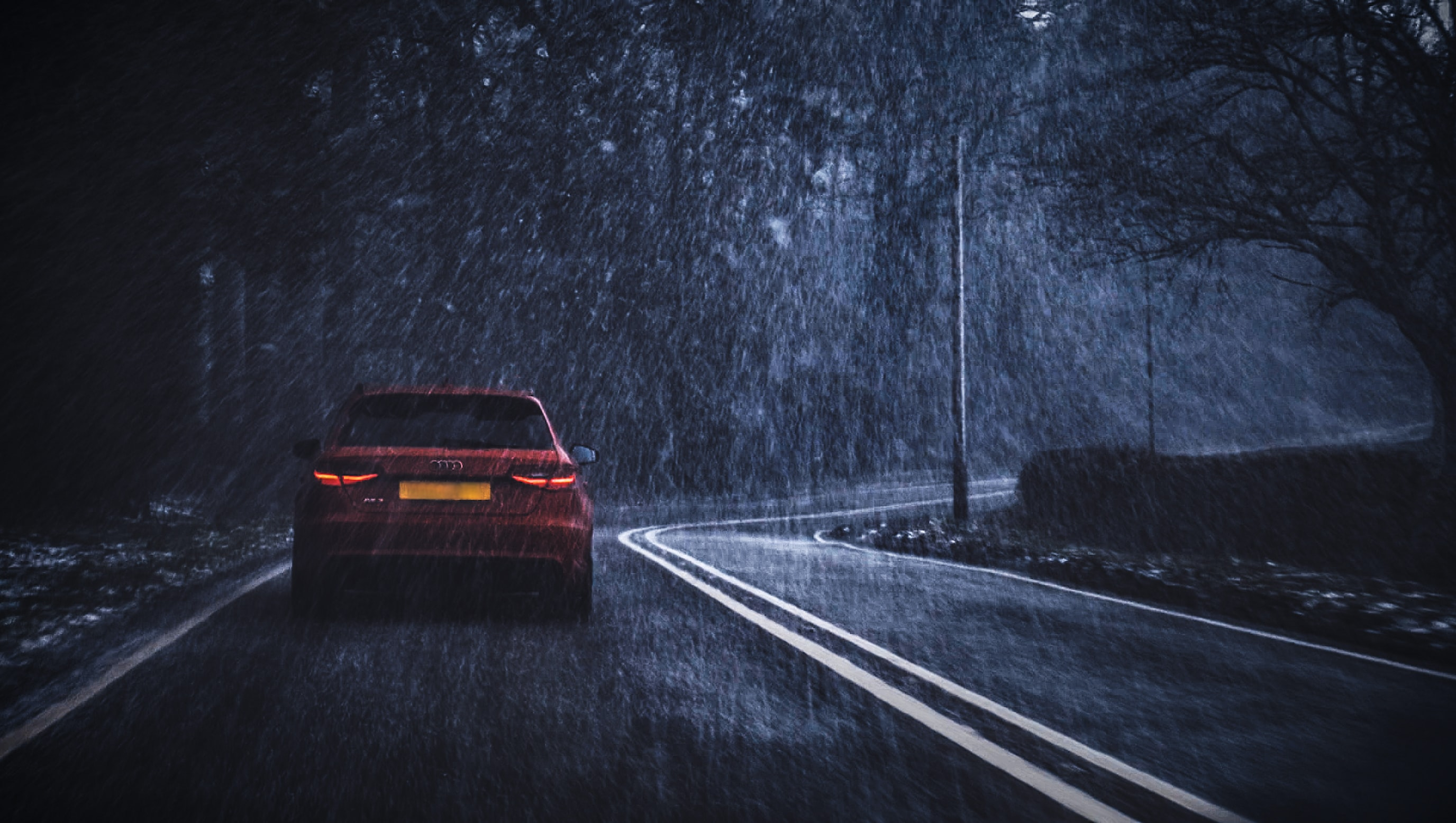 red car on road while raining