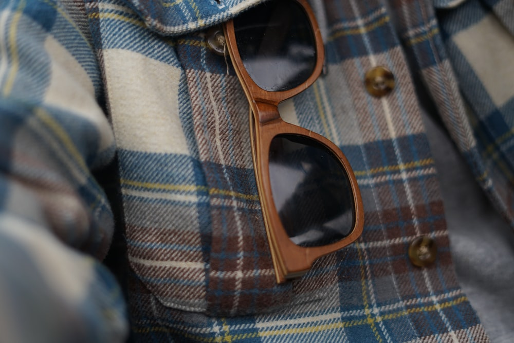 black sunglasses with brown frames