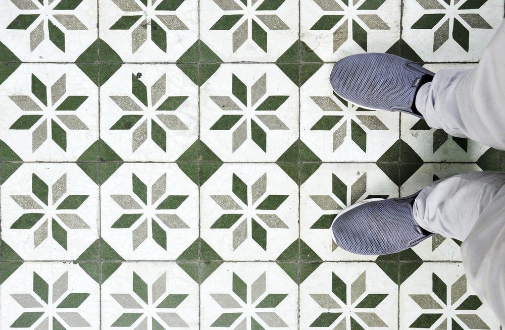green and white tile flooring