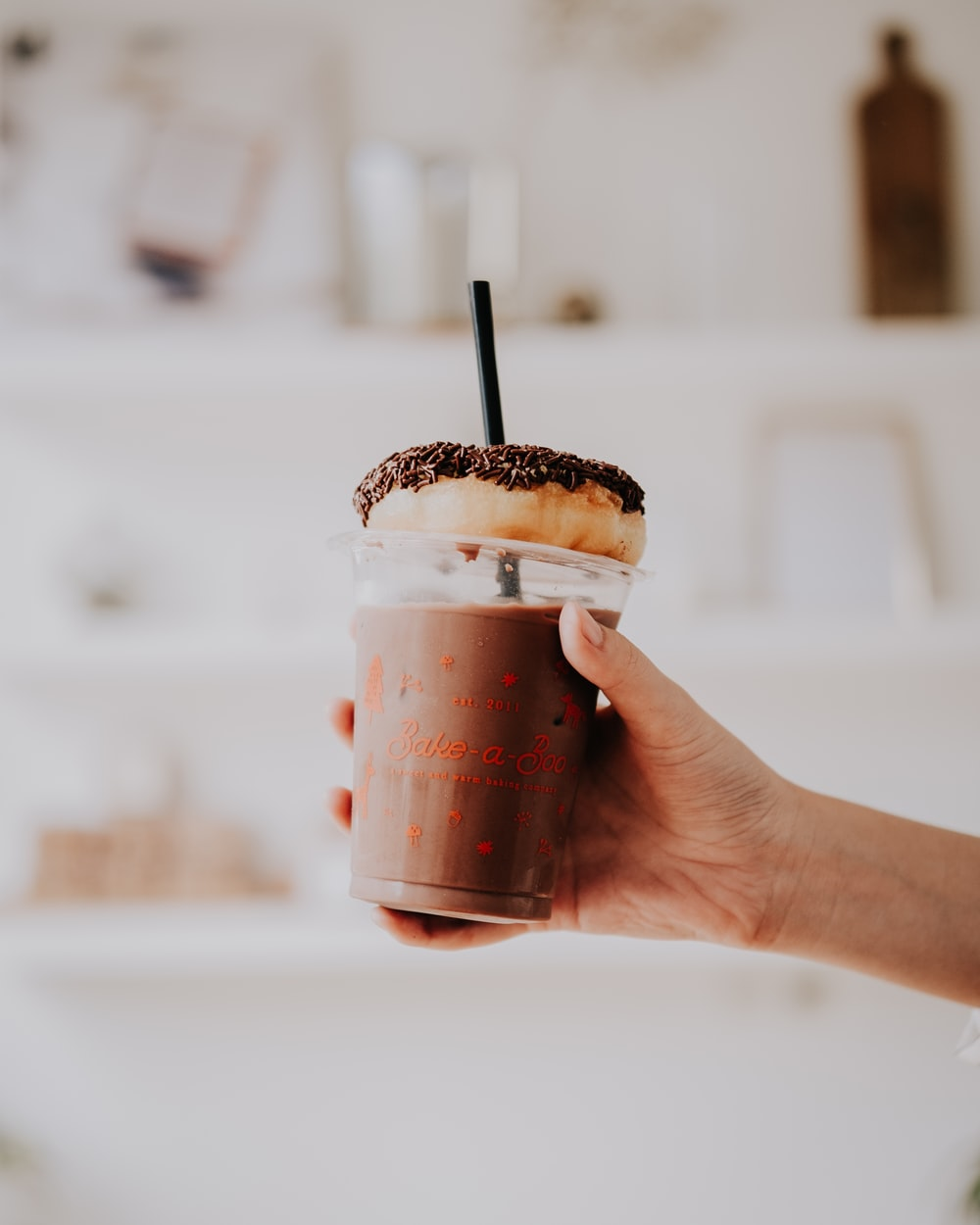 person showing chocolate shake