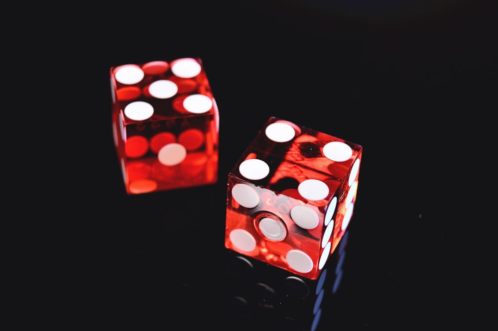 two red-and-white dices