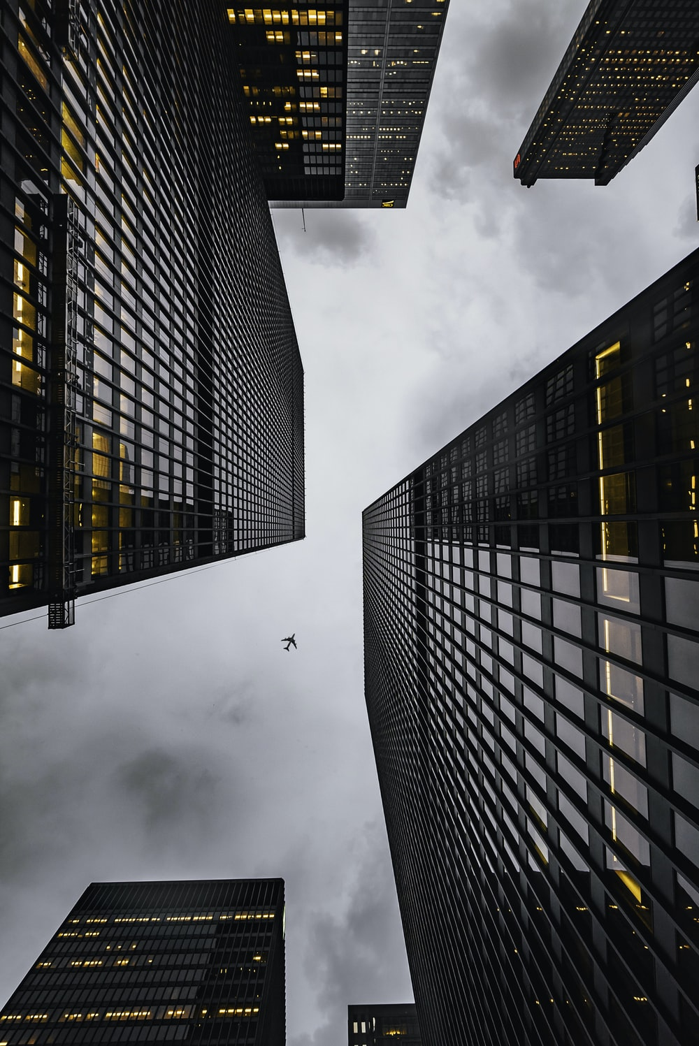 low angle photo of black high rise concrete city buildings