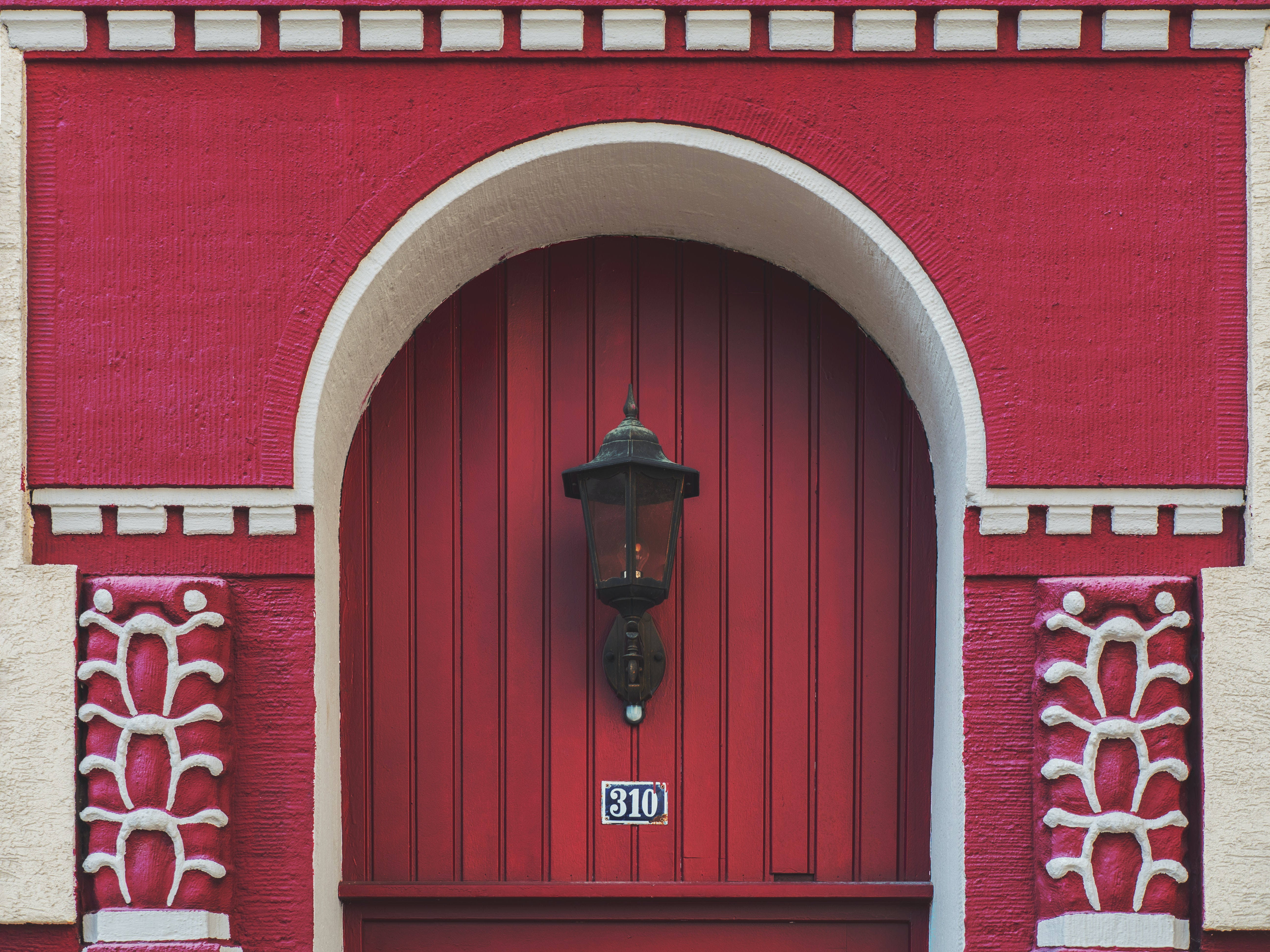 black wall sconce hanging on red wall