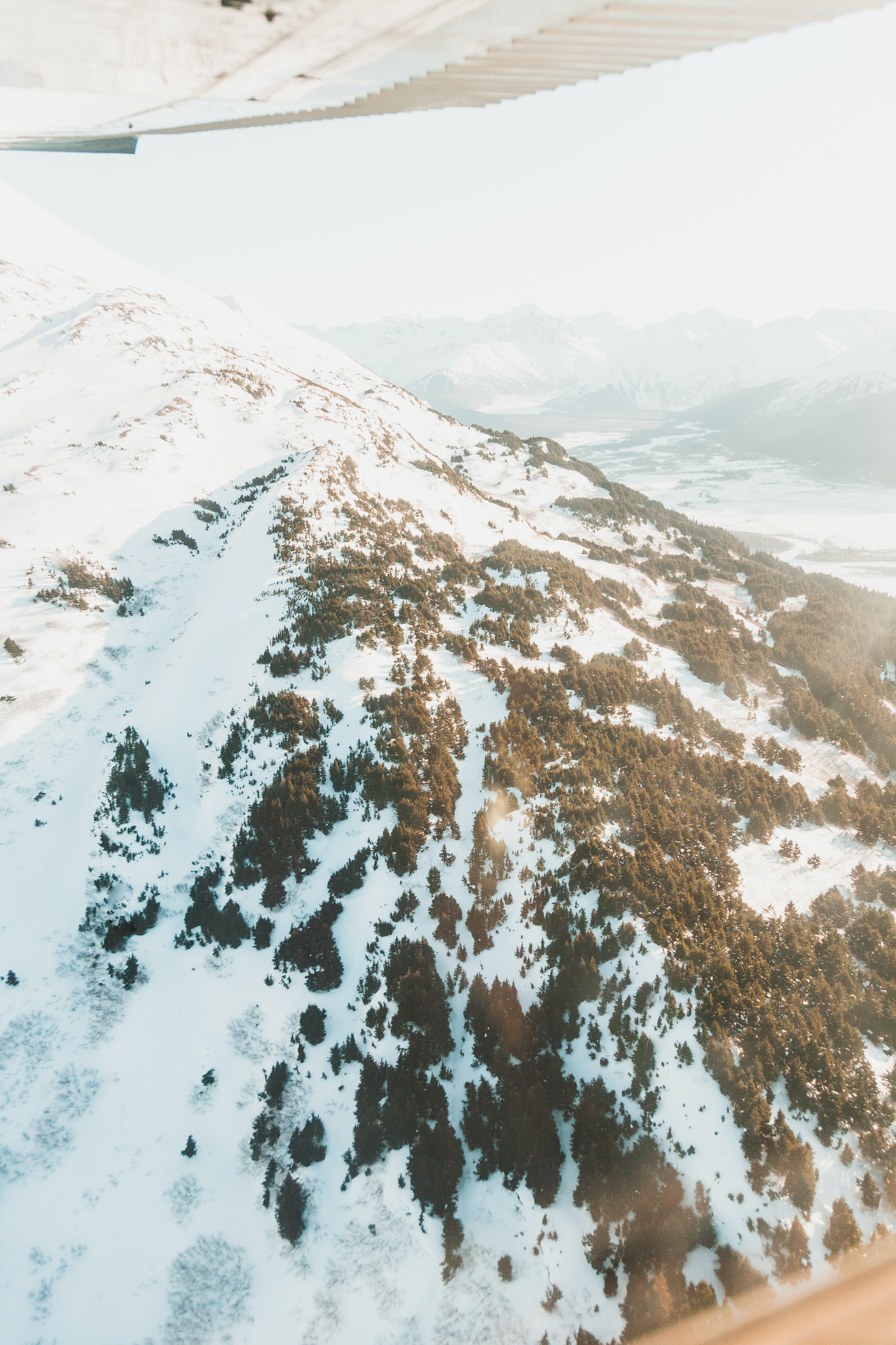 aerial photo of mountain covered with snow