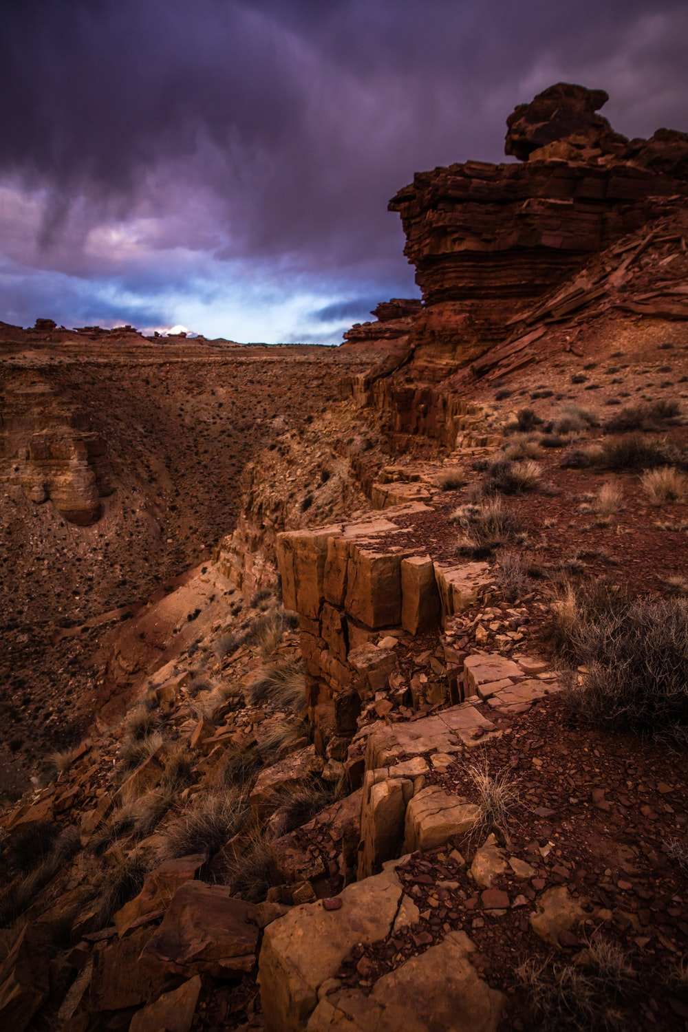 brown canyon under gray clouds at daytime