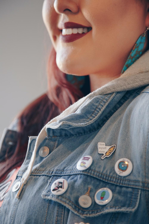smiling woman wearing blue denim collared shirt