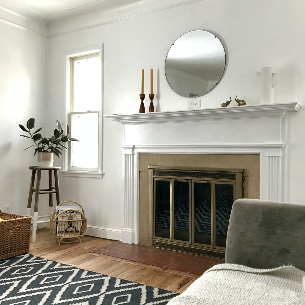 room with white wall and wooden floor