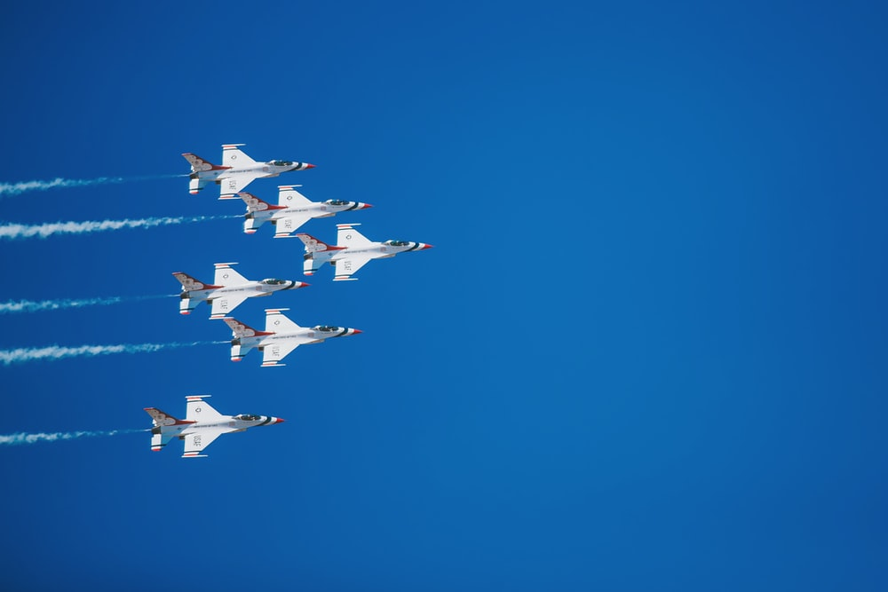 time lapse photography of five jet planes
