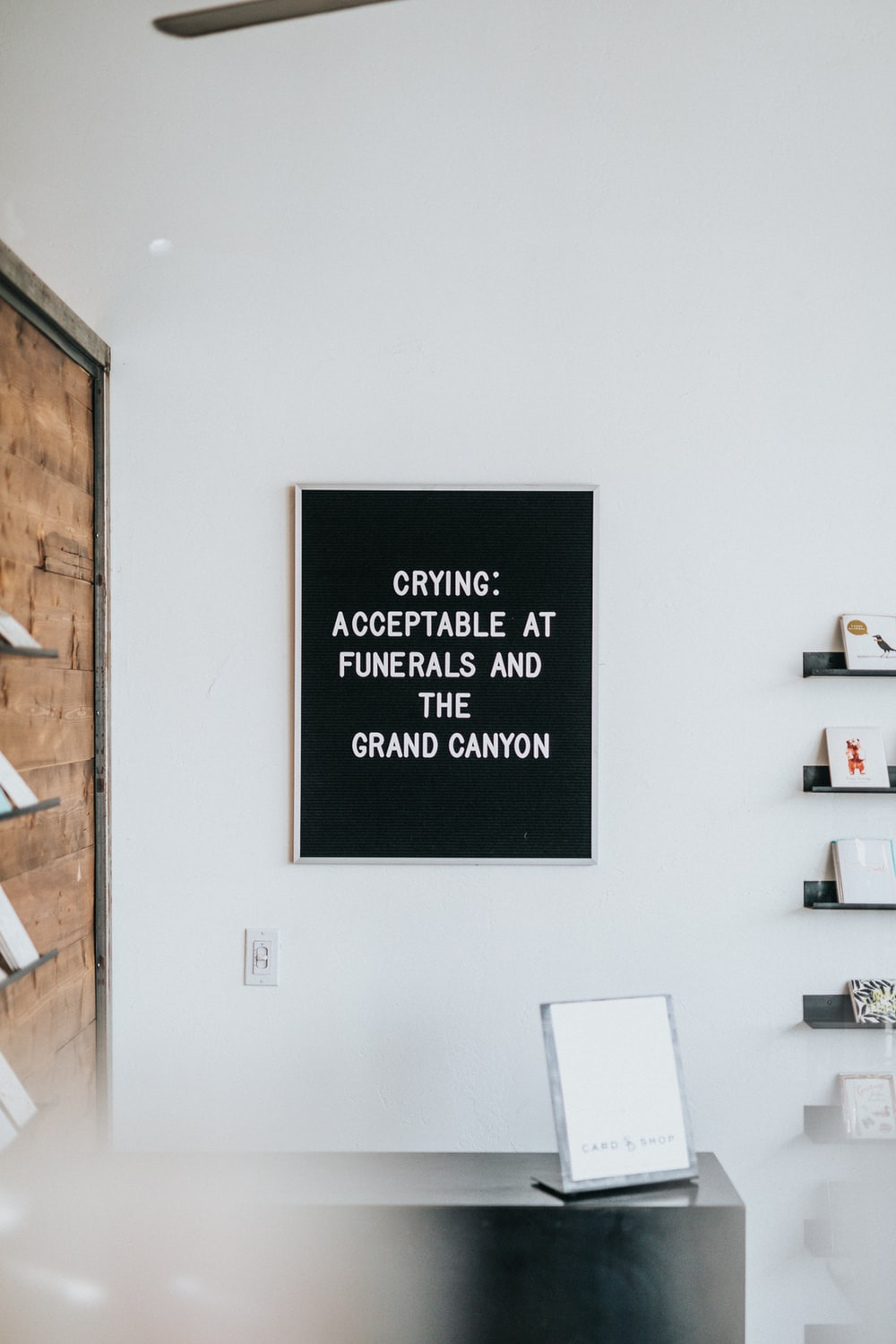 black and white quote printer decor hanged on white wall