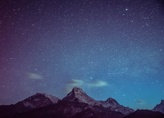 icy mountains under starry night