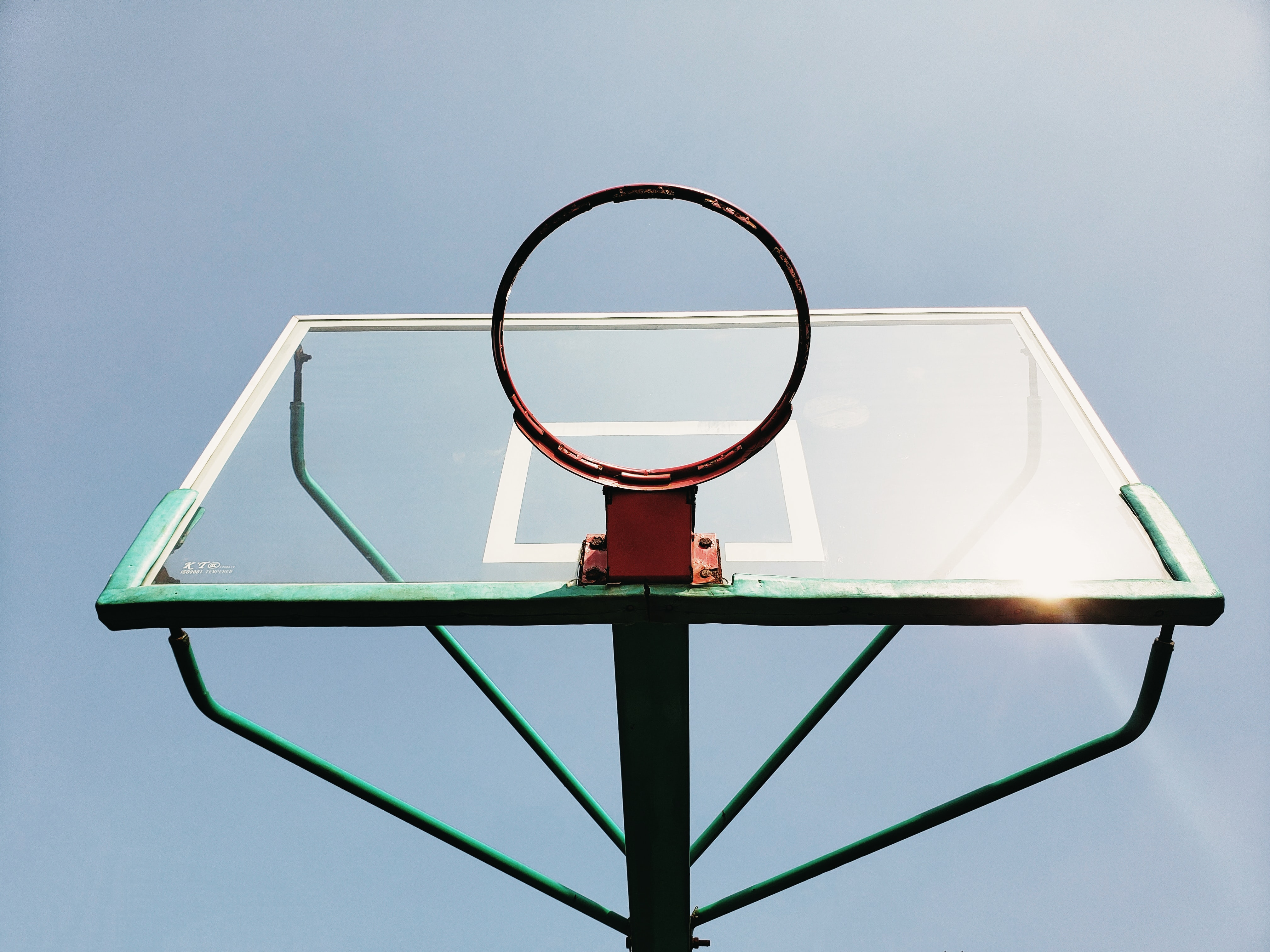 low-angle photography of green and red basketball system at daytime