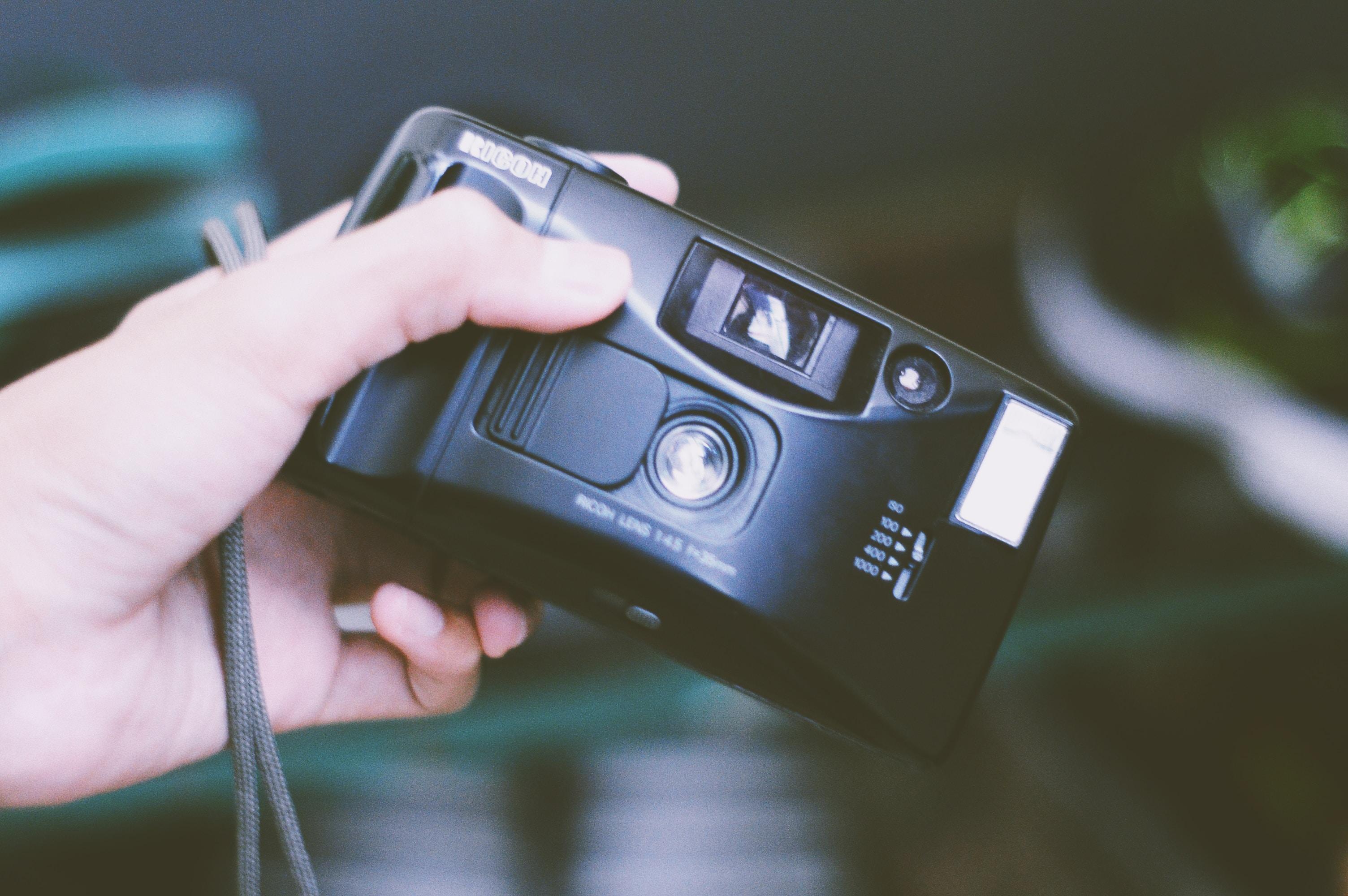 person holding filmed camera