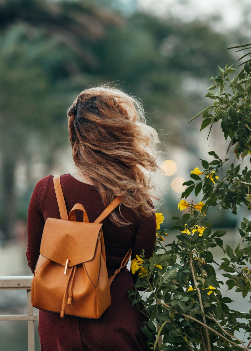 woman carrying brown leather backpack photo – Free People