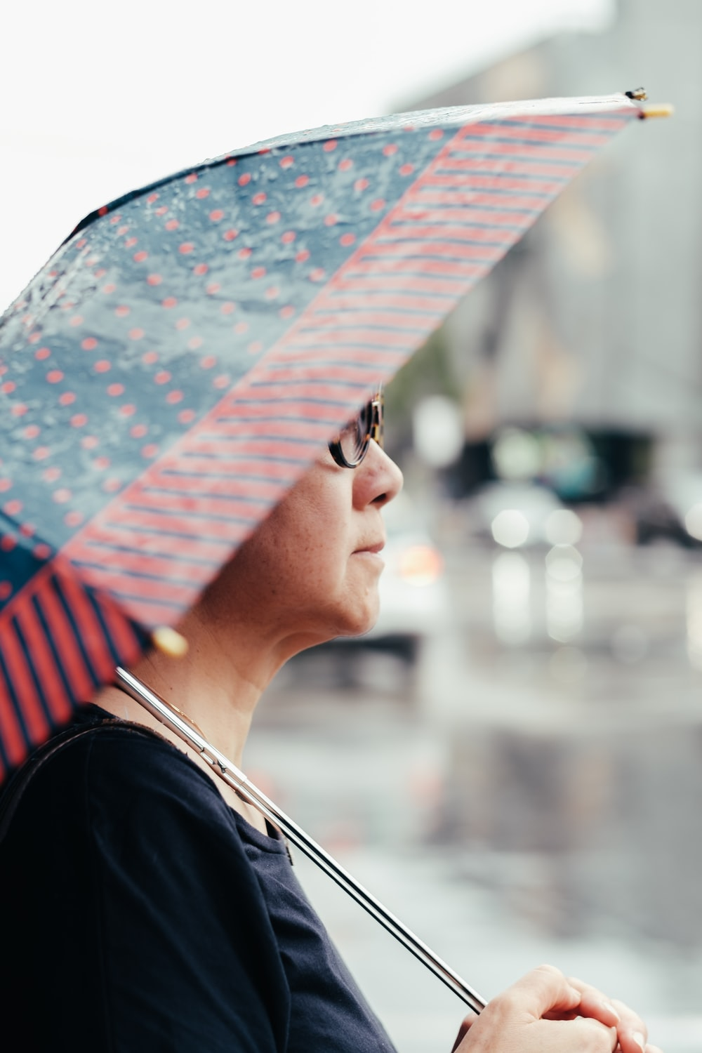 selective focus photo of woman holding umbrella
