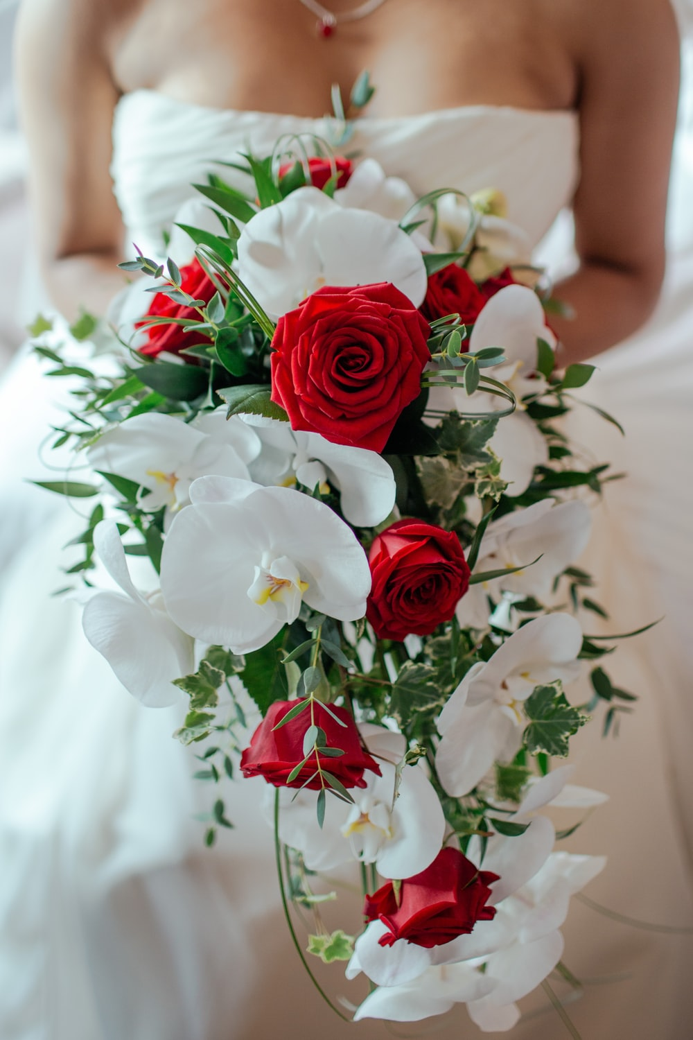 500 bouquet pictures download free images on unsplash red rose and white orchid bouquet izmirmasajfo