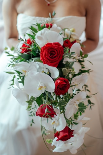 a bride with her cascading wedding bouquet