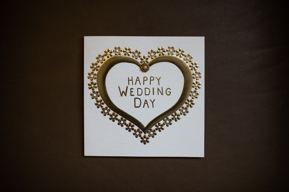 white happy wedding day card on brown surface