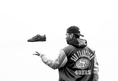 person throwing his shoe 49ers zoom background