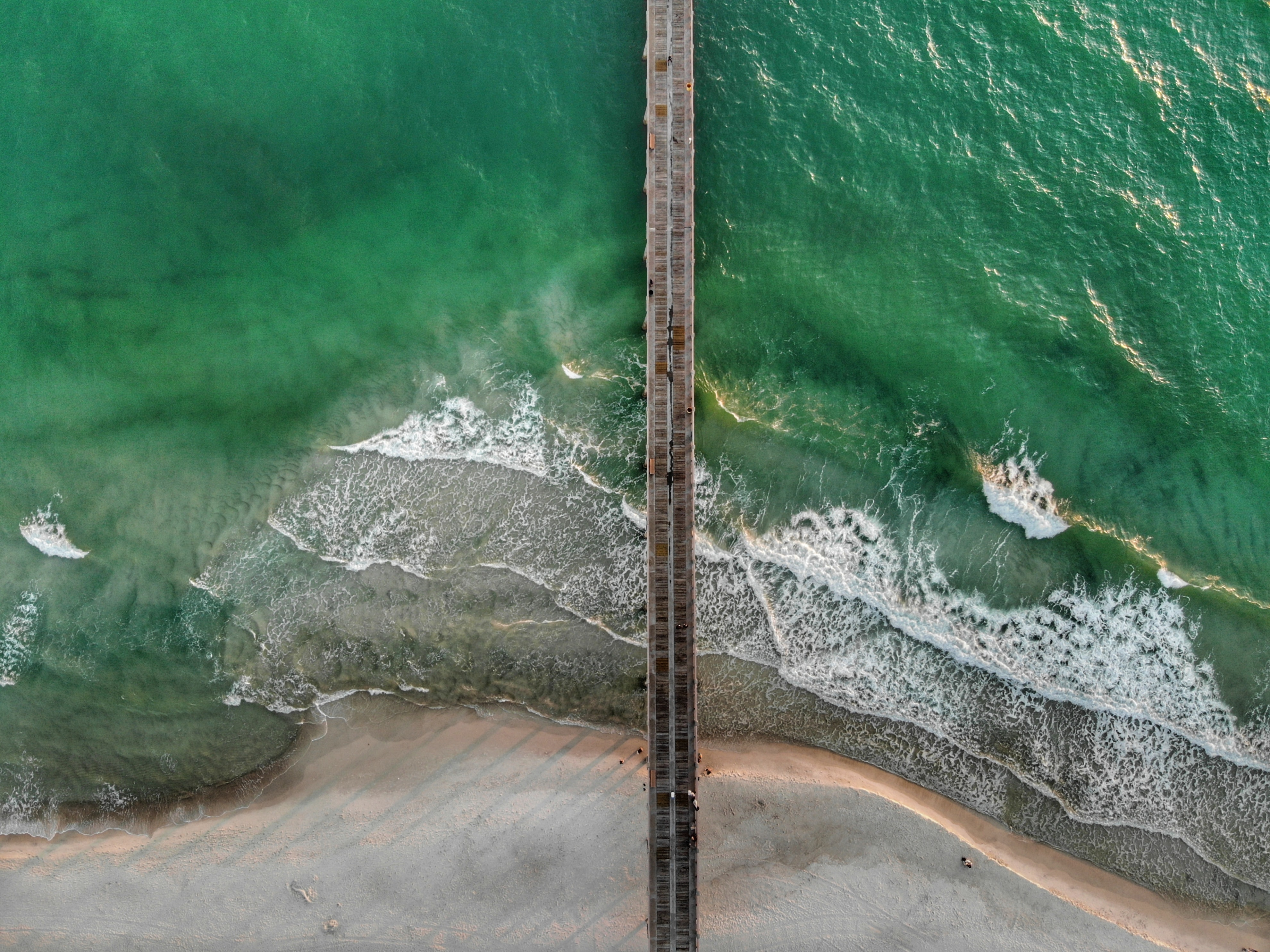 high angle photography of brown sea dock at day time