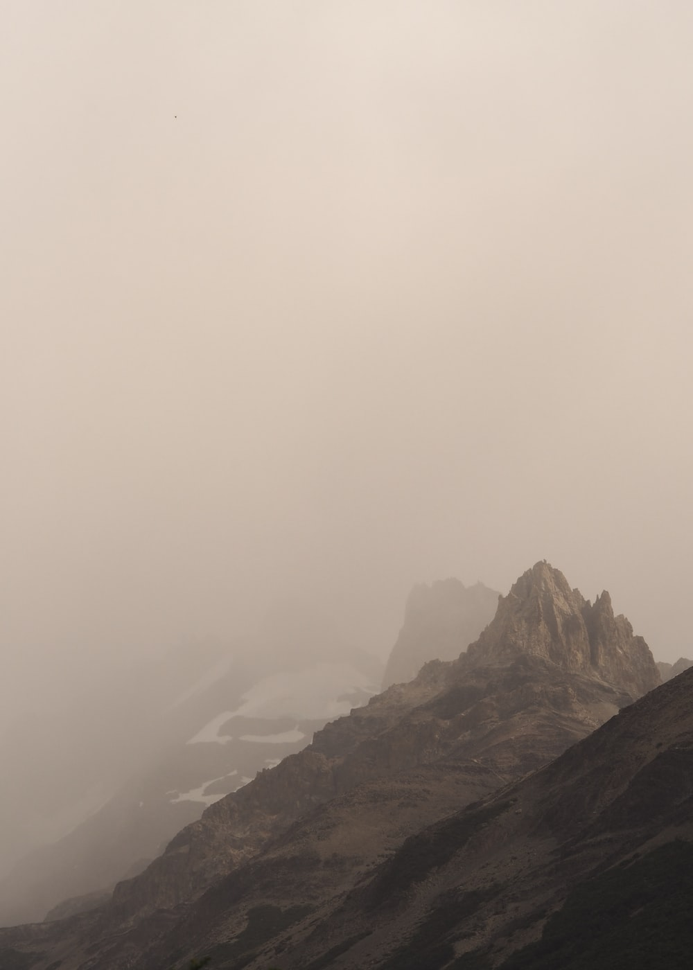 gray mountain covered by fog