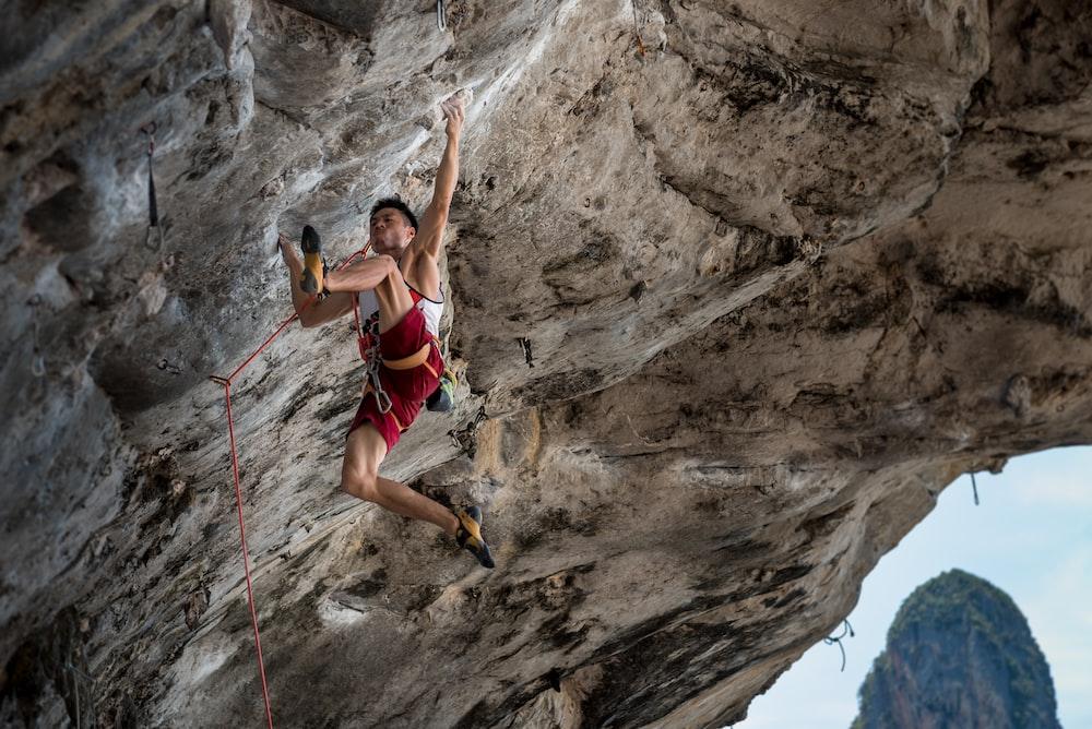 female doing cliff hanger