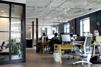 people working inside white and black room