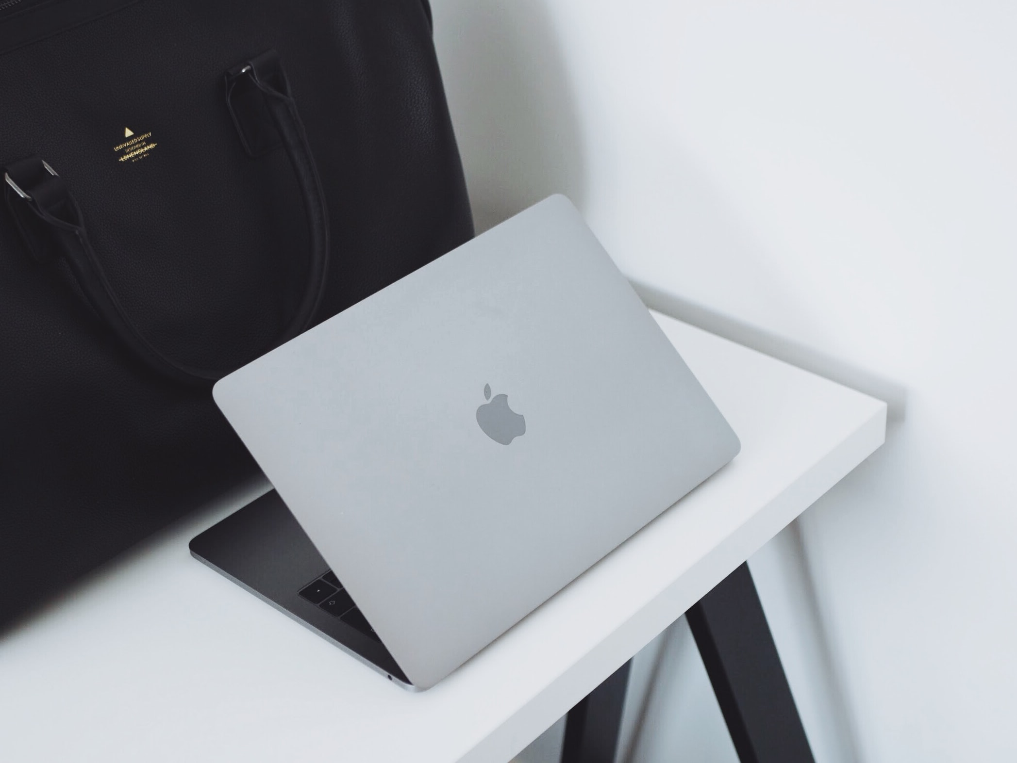 opened MacBook on table