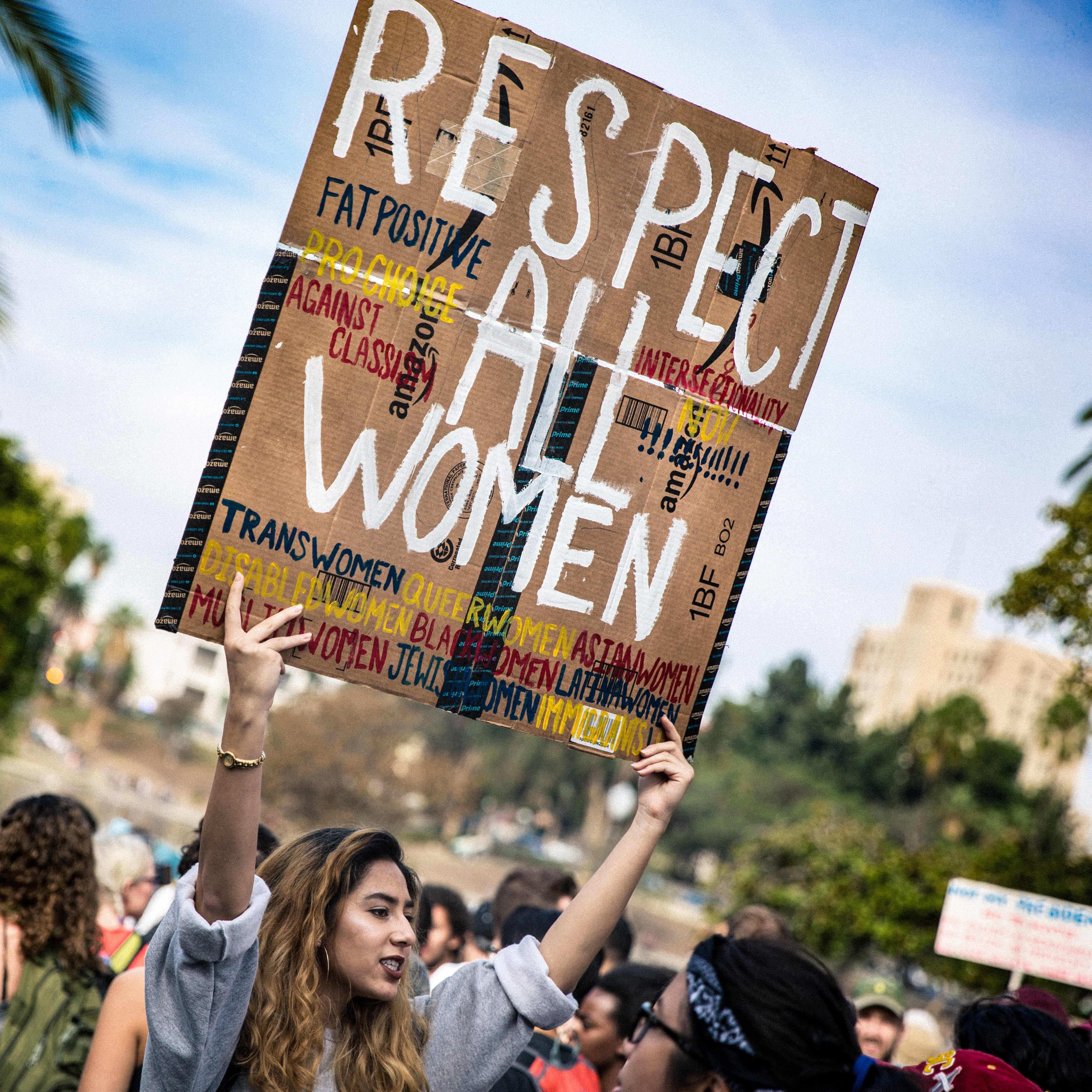 woman holding respect all women poster