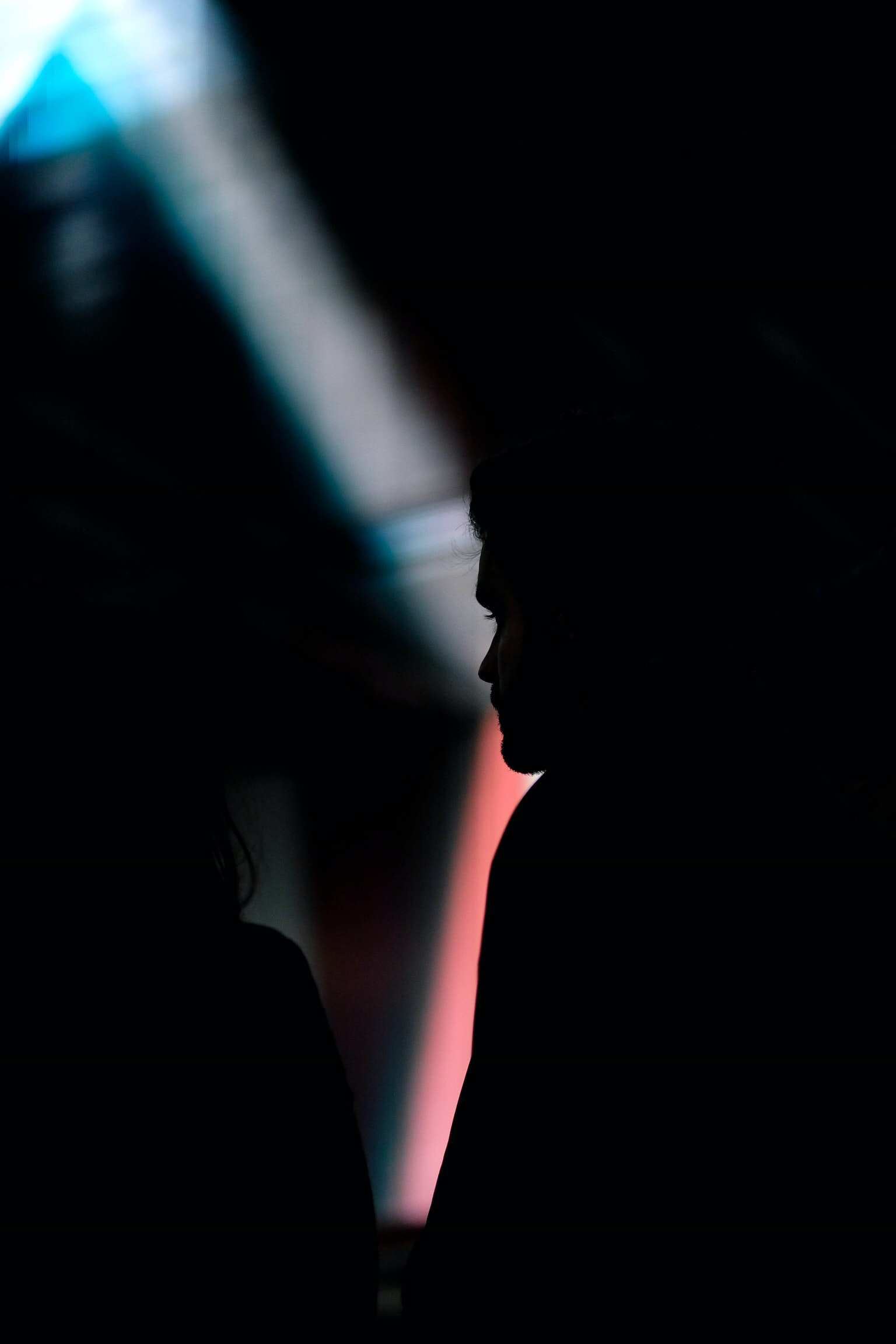 silhouette of two person